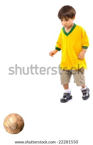 Child with a brazilian T-shirt playing football . - stock photo