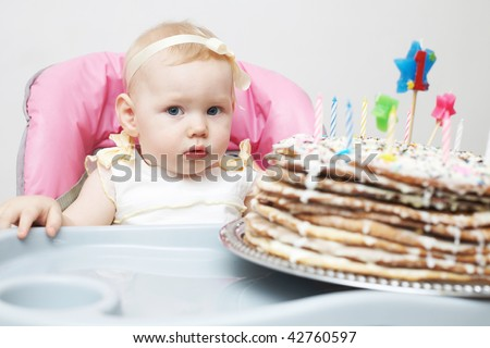 child with a cake - stock photo