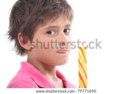 Child with a giant sweet - stock photo