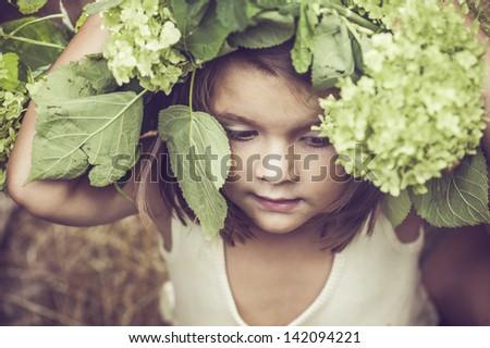 child with a massive wreath - stock photo