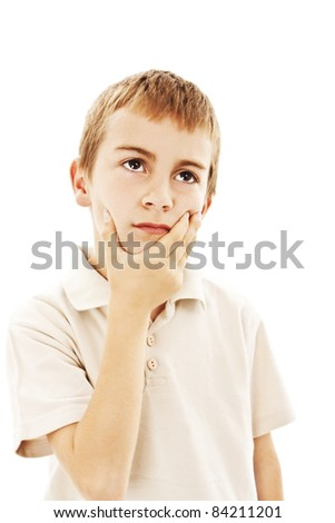 Child with a pensive expression looking up. Isolated on white background. - stock photo