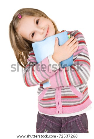 child with a stack of notebooks - stock photo