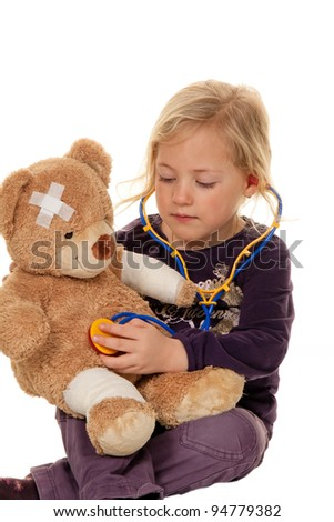 child with a stethoscope as a medical doctor. pediatrician examined patients - stock photo