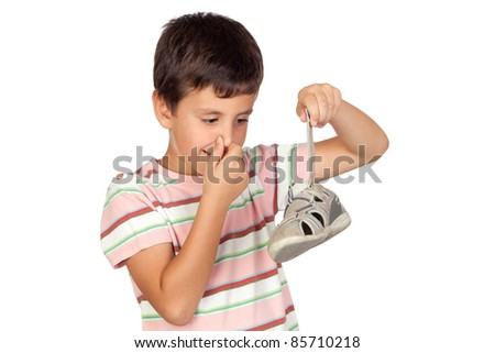 Child with a stuffy nose taking the sandal isolated on for Male urine smells like fish