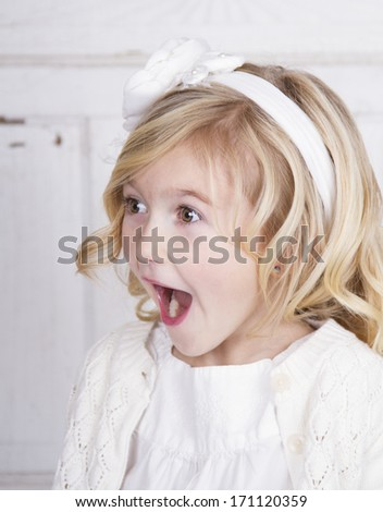 Child with a surprised or shocked look on face - stock photo