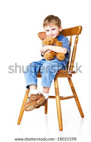 Child with a teddy bear on a chair