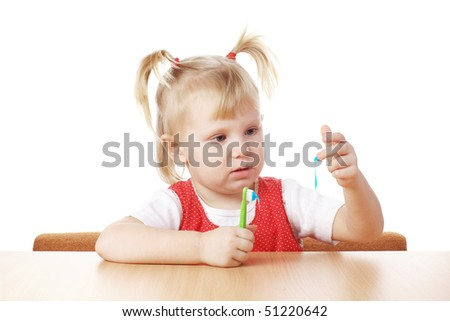 child with a teeth brush - stock photo
