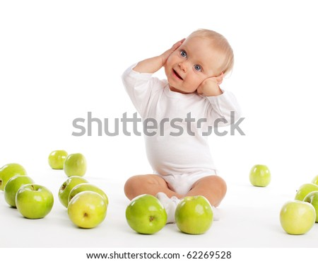 Child with apple isolated on white