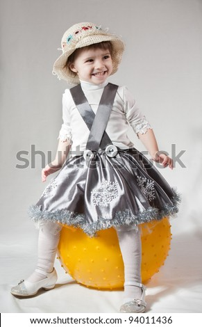 Child with ball, on white background. - stock photo