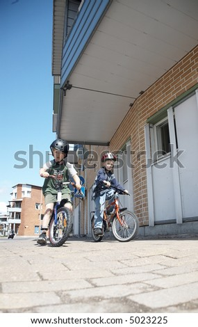 Child with bicycle - stock photo
