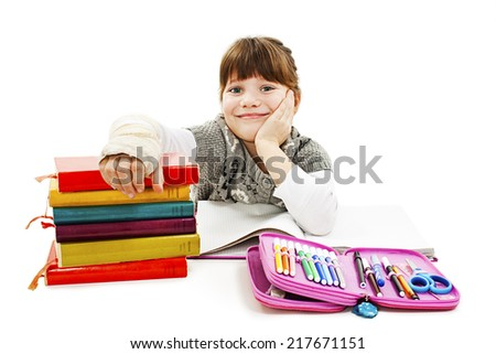 Child with broken arm in classroom, studio shoot. Isolated on white background  - stock photo