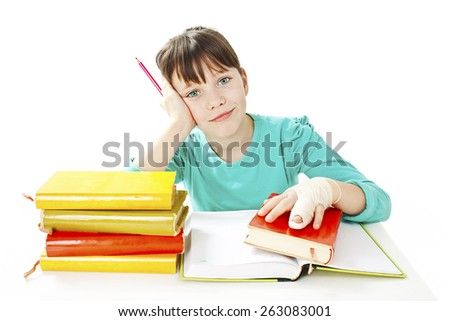 Child with broken hand in classroom, studio shoot. Isolated on white background - stock photo