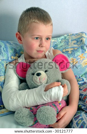 child with broken hand in plaster - stock photo