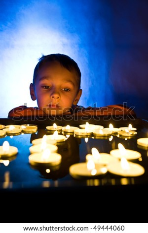 Child with candles - stock photo