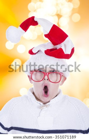 child with Christmas hat