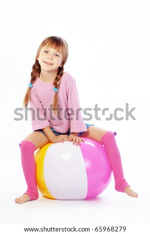 Child with colorful ball on white studio background - stock photo