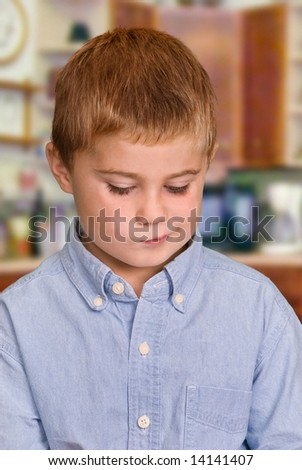 Child with concerned expression - stock photo