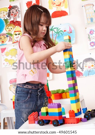 Child with  construction set in play room. Preschool. - stock photo