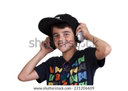 child with current clothing with headphones listening to music - stock photo