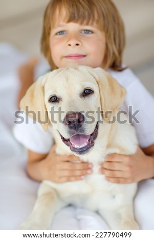 Child with dog - stock photo