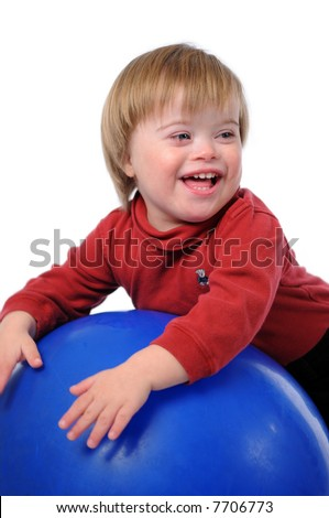 Child with Down Syndrome smiling playing with ball isolated over a white background. - stock photo
