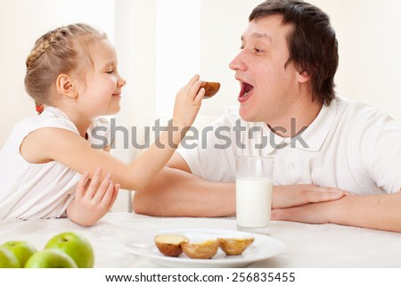 Child with father have a breakfast. Family eating at home