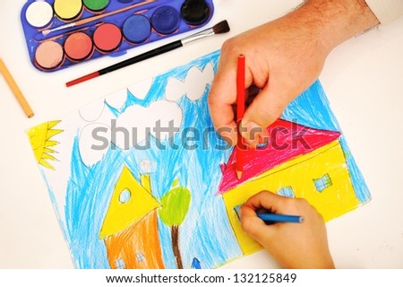 child with friends painting on paper the house - stock photo