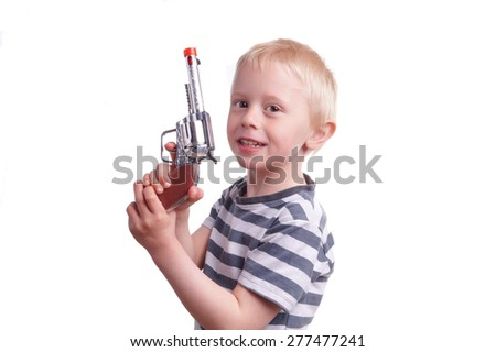 Child with gun. The boy playing police and robber. Isolated on white background - stock photo