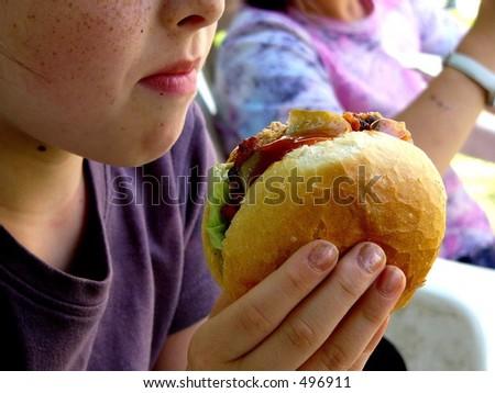 Child with hamburger - stock photo