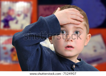 Child with hand to forehead - stock photo