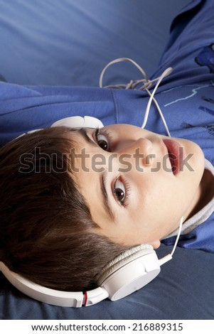 child with headphone - stock photo