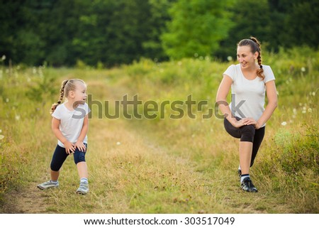 child with her mother on the nature train - stock photo