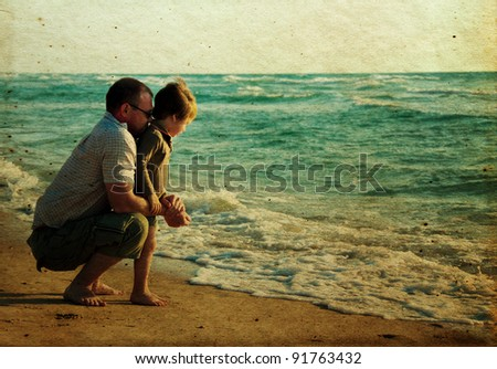 child with his father at sea. Photo in old color image style. - stock photo