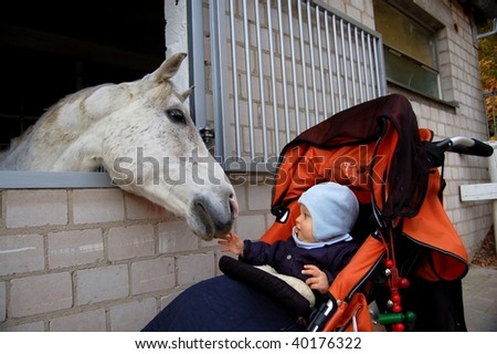 Child with horse - stock photo