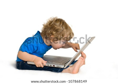Child with laptop - stock photo