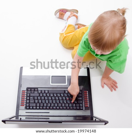 child with laptop push button on white background - stock photo