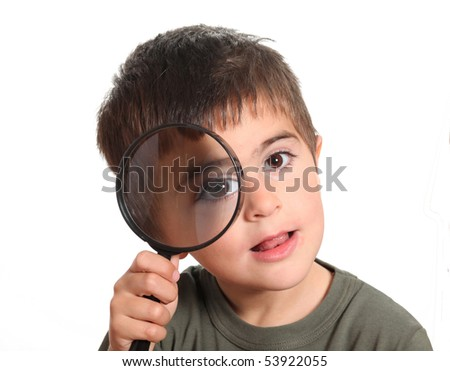 child with magnifying glass isolated on white background