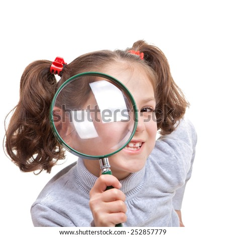 child with magnifying spy glass - stock photo
