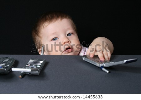 Child with mobile phones, isolated on a black background