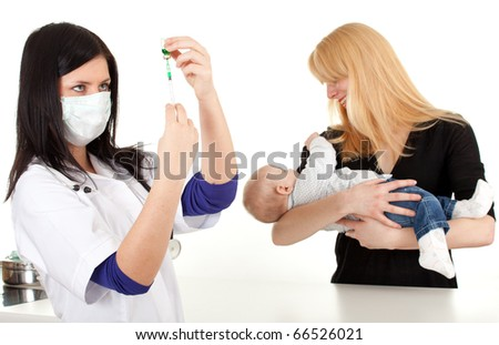 child with mother at doctor - female doctor prepare syringe for injection and examining baby - stock photo