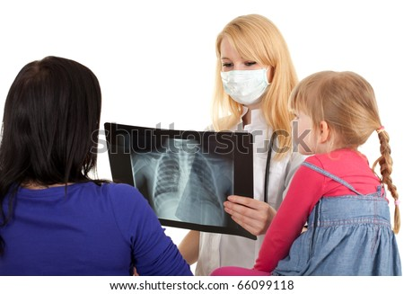 child with mother at doctor - female doctor reading x-ray chest and examining little girl - stock photo