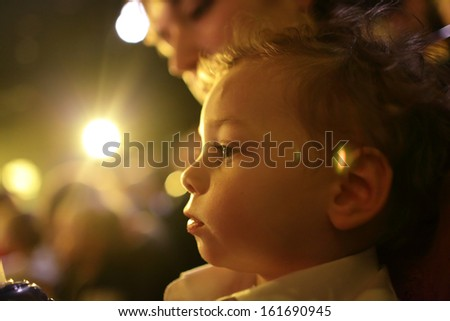Child with mother enjoying time in the theater - stock photo