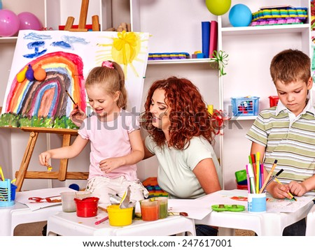 Child with mother painting . Lesson in child club - stock photo