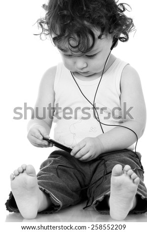 Child with mp 3 player,isolated on a white background. - stock photo