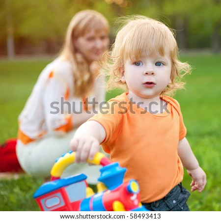 child with mum on walk - stock photo
