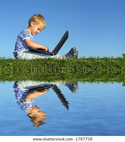 child with notebook sit blue sky and water - stock photo