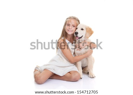 child with pet puppy dog - stock photo