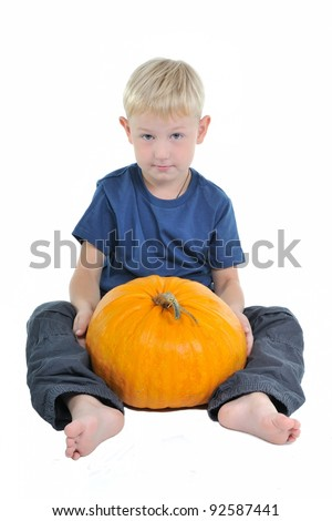 Child with pumpkin isolated