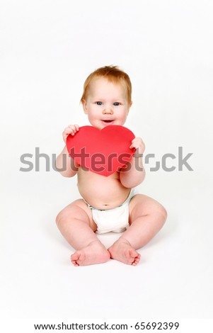 Child with red heart in hands on a white background - stock photo