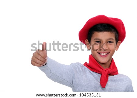 Child with red scarf and beret - stock photo
